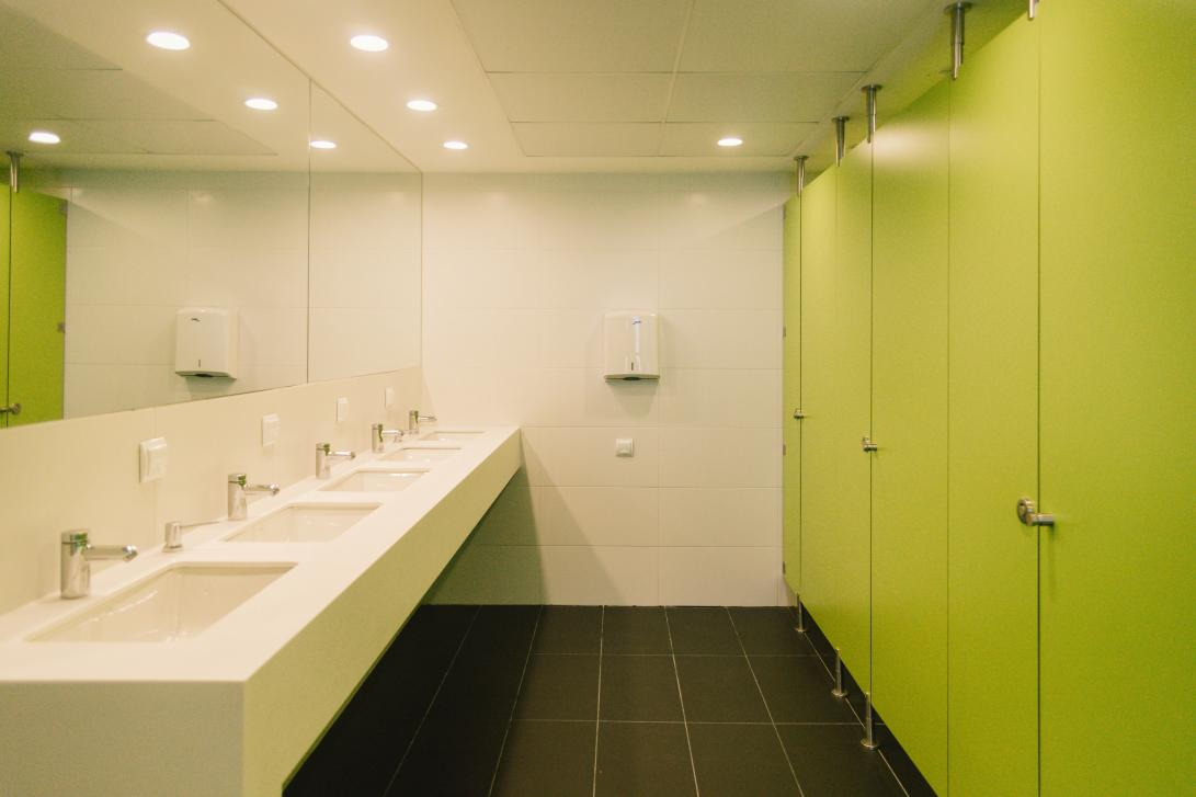 Shared bathroom with shower cabins and individual toilet cubicles, separate from the bedrooms to avoid damp and smells.